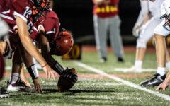 Center Robert Schuster snaps the ball effortlessly to quarterback Nick Carey
