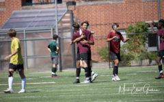 Captain Almeida and Gino Tripoli celebrate a late equalizer in their preseason scrimmage against Manchester-Essex