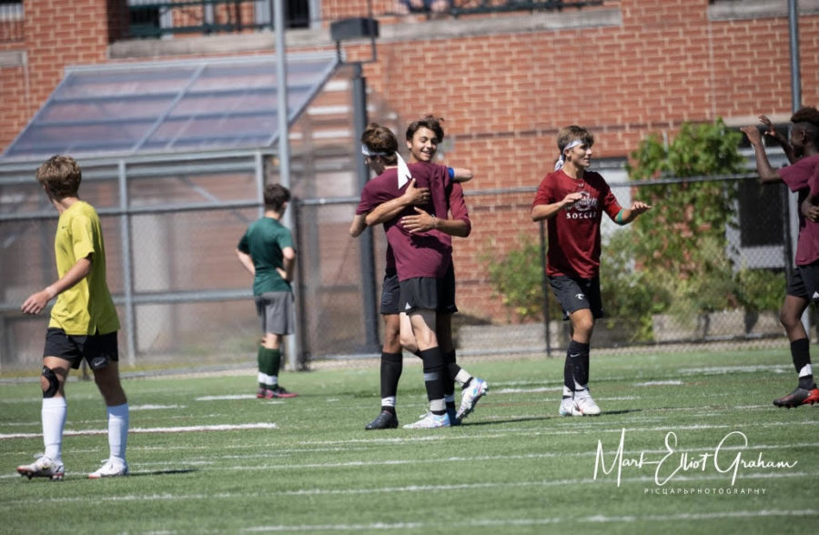 Captain+Almeida+and+Gino+Tripoli+celebrate+a+late+equalizer+in+their+preseason+scrimmage+against+Manchester-Essex+