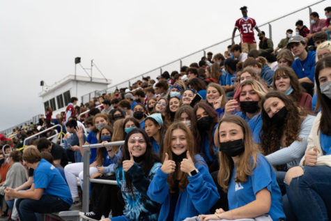 The junior class shows its school spirit dressed in blue while awaiting dismissal after evacuation on Friday.