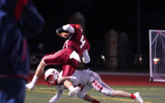 Nick Carey runs the ball for a touchdown against the Sachems