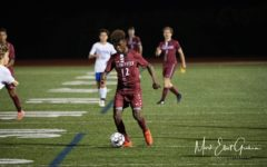 Geremy Palacios, shown taking the ball up the field, had his first career hat trick on Saturday against Dracut